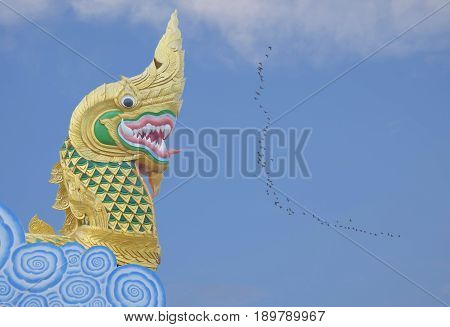 Naga statue head with blue sky background