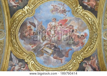 ROME, ITALY - SEPTEMBER 02: The fresco of virtue Charity on the little cupola of side nave in Basilica dei Santi Ambrogio e Carlo al Corso by Pio Paolini from (1678 - 81), Rome on September 02, 2016.