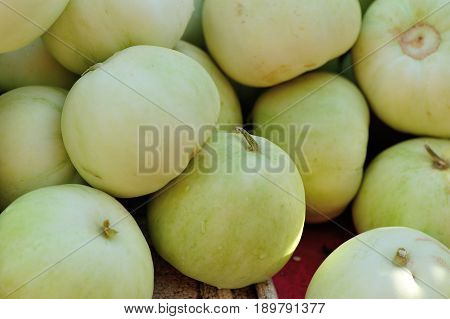 closeup of fresh honeydew melon fruits selling at market