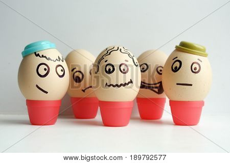 Eggs With Painted Face. Concept Team