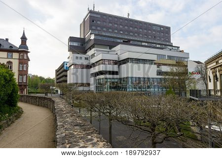 SCHWEINFURT GERMANY - APRIL 21 2017: Shopping and entertainment center office building and the Panorama Hotel in the old part of the city.