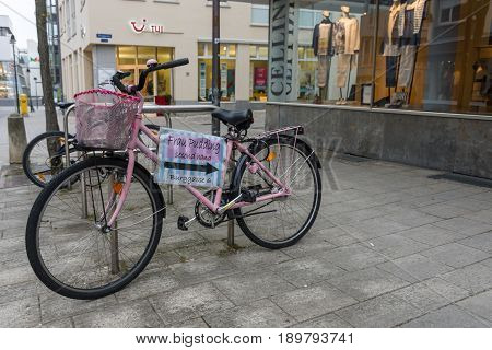 SCHWEINFURT GERMANY - APRIL 21 2017: Pointer to a second-hand shop on an old bicycle in the historic part of the city. Schweinfurt - a medieval city founded in 761 year.