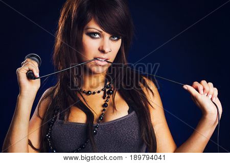 Beautiful woman singer with microphone