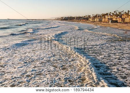 Waves head towards the beach in the city of Oceanside, California, located in San Diego County.
