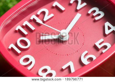 Closed up of red square clock (Concept of deadline) poster