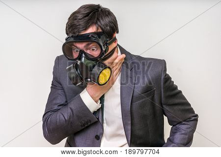 Businessman With Gas Mask Can Not Breathe Bad Air