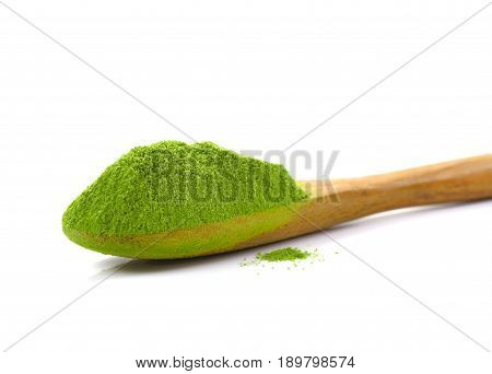 matcha powder green tea with bamboo spoon isolated on white background