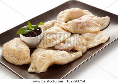Dumplings - sweet stuffed cheese noodles with jam on white background