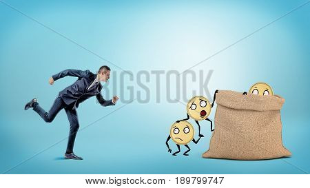 A small businessman running to a large full sack where many coins with arms and legs are getting in. Know where money are. Wise banking. Profitable investment.