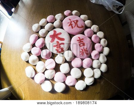 Pink and white, Japanese mochi arranged in a circle