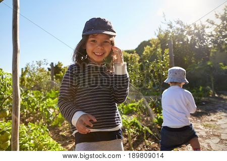 Two Children Playing On Allotment Together