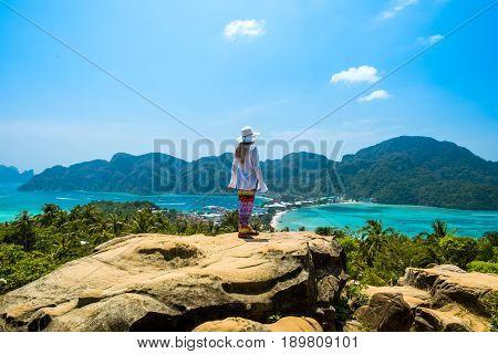Tourist woman admire tropical Thailand Phi phi island and lagoon