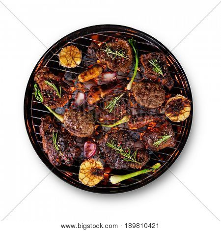 Fresh beef steaks, chicken legs, sausages meat and skewers with vegetable placed on grill, isolated on white background. Cooking, preparation and barbecue objects.