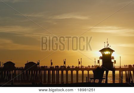 Setting Sun Through Huntington Beach Pier Tower