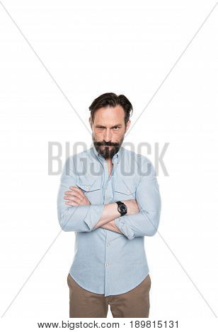 Serious Bearded Man Standing With Crossed Arms And Looking At Camera