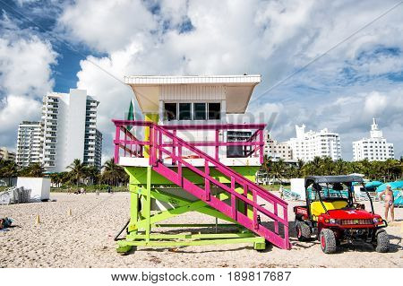 Wooden Lifeguard Tower And Jeep Car On Sandy Beach