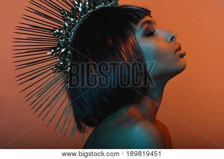 Side View Of Stylish African American Girl In Headpiece With Eyes Closed