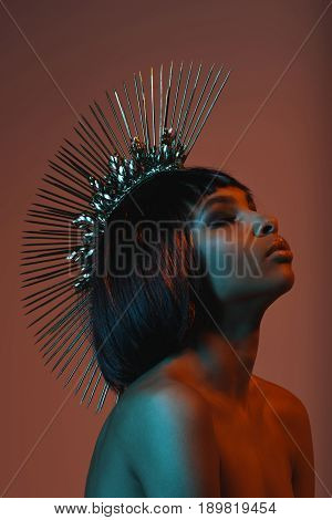 Young Sensual African American Girl In Fashionable Headpiece With Eyes Closed