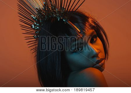 Fashionable African American Girl In Headpiece With Needles Looking At Camera