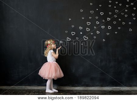 little cute girl a good 4 years send a kiss - drawn hearts. love valentine's day concept