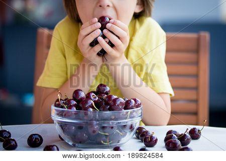 Cute Little Boy, Eating Sweet Cherry Outdoors