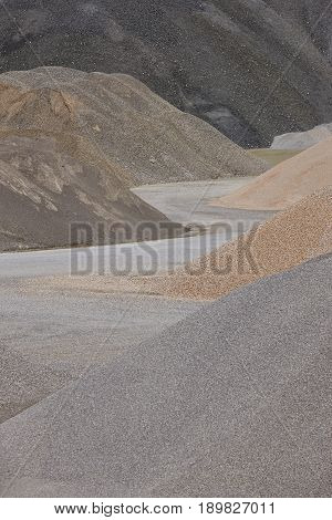 Different kinds of stone on a gravel quarry. Construction background