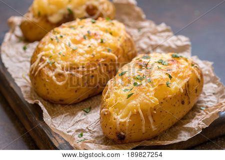 Baked stuffed potatoes with cheese, sour cream and bacon