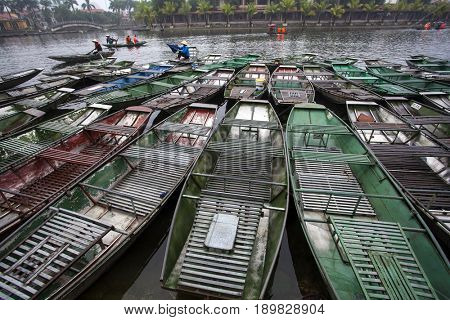 Close up on colorful traditional boats on the river in Tam Coc,Vietnam. Vietnam travel landscape and destinations background.