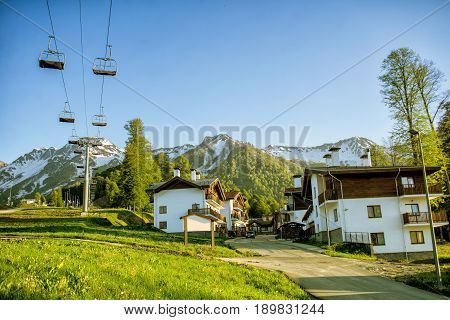 A Canopy Chairlift And Chalet In Mountains Morning. Rosa Khutor In The Summer, Adler