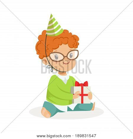Adorable baby boy wearing a green party hat sitting with gift box. Childrens birthday party colorful cartoon character vector Illustration isolated on a white background