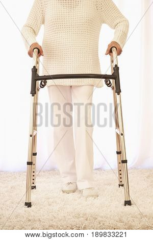 Older Caucasian woman using walker