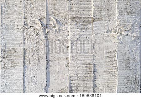Texture of wooden formwork stamped on a raw concrete wall as background. Vertical strips from formwork