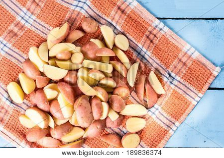 Sliced Raw Potatoes Drying  On The Kitchen Tablecloth