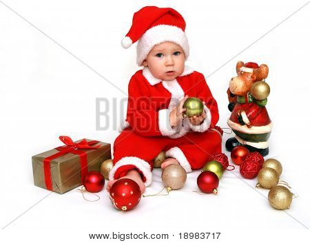 12 months old baby boy dressed in santa claus costume