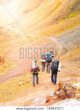 Group of hikers going up the path at Landmannalaugar, Laugavegur trek, Iceland.