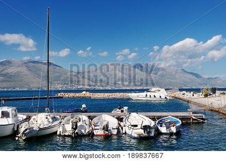 White boats in the sea of the port of Gaeta Lazio Italy