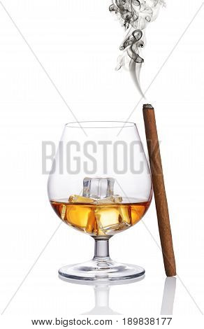 Glass Of Strong Alcoholic Drink Scotch Whiskey With Ice Cube And Smoking Cigar