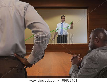 Businessman drawing chart for colleagues
