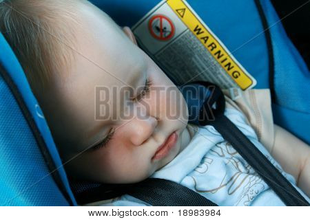 9 months old baby boy sleeping in car seat