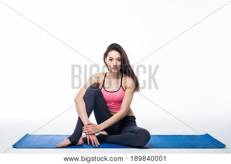 Sporty Young Woman Doing Yoga Practice Isolated On White Background