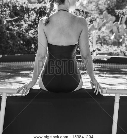 Healthy Woman In Swimming Pool Looking Into Distance Sitting