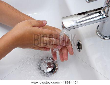 Child hand washing in the washbasin
