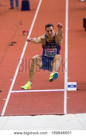 BELGRADE SERBIA - MARCH 3-5 2017: MAN LONG JUMP HEPTATHLON DUDAS MIHAIL EUROPEAN ATHLETICS INDOOR CHAMPIONSHIPS IN BELGRADE SERBIA