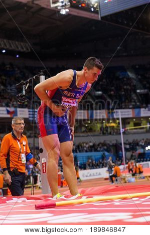 BELGRADE SERBIA - MARCH 3-5 2017: MAN HEPTATHLON HIGH JUMP DUDAS MIHAIL EUROPEAN ATHLETICS INDOOR CHAMPIONSHIPS IN BELGRADE SERBIA