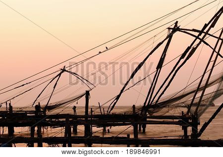 India Chinese fisching nets in Cochin at the sunset