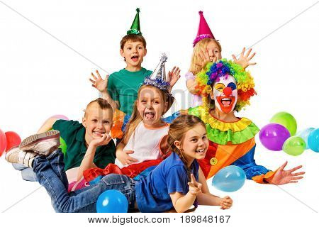 Birthday child clown playing with children and bunny fingers prank. Kid holiday cakes celebratory and balloons the happiest birthday. Fun of group people pose for camera on white background. Small