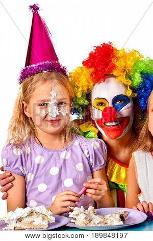 Birthday child clown eating cake with girl together. Kid with messy face have tier cake fight on isolated. Birthday of the house.