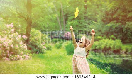 Girl Have Fun With Pinwheel Toy
