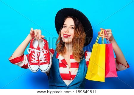 Woman With Shopping Bags And Gumshoes