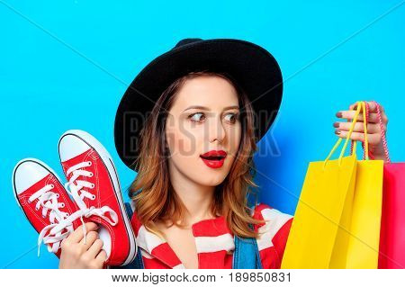 Woman With Gumshoes And Shopping Bags